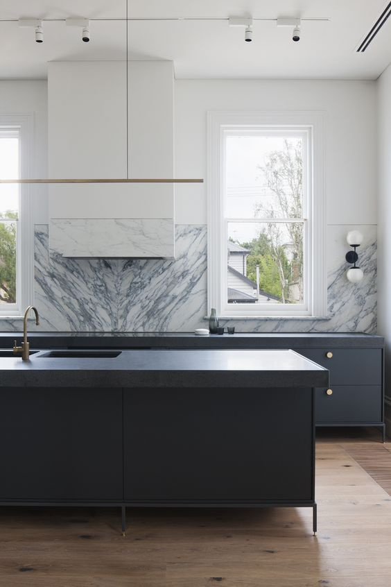 kitchen with no wall storage, freestanding island and base cabinets, statement marble backsplash book matched