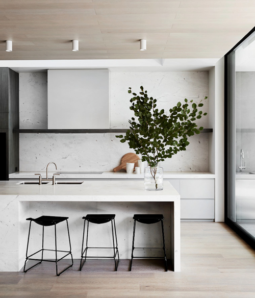 scandi minimal kitchen with single floating shelf and full height storage